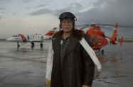 Rear Adm. David W. Kunkel, Coast Guards Seventh District Commander, poses for one of his final Ancient Albatross pictures before he will hand over the honor to Vice Adm. Vivian Crea in June. Kunkel, the 20th Ancient Albatross, was awarded the honor in May 2006 for being the active duty member who has held an aviation designation for the longest period of time. (USCG photo by PA1 Jennifer Johnson)