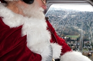nyca-mofsanta-12_17-jh-santa-checks-the-view-of-seattle