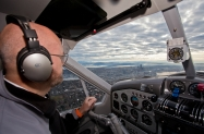 nyca-mofsanta-12_17-pilot-doug-devries-takes-the-plane-over-downtown-seattle-on-approach-to-kbfi