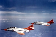 a 1280px-F8F-8T_Cougars_of_VMT-1_in_flight_in_1962