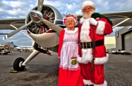 nyca-mofsanta-12_17-jdl-the-clauses-pose-before-their-beaver-floatplane-before-taking-off